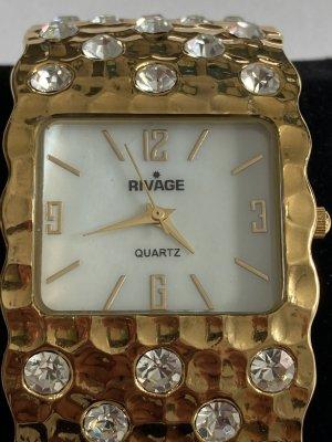Stojak na zegarek złoto