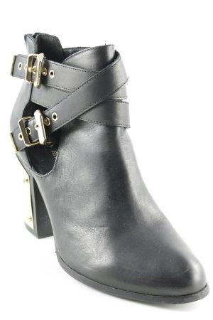 River Island Cut-Out-Stiefeletten schwarz-goldfarben Street-Fashion-Look