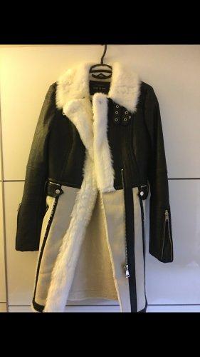 River Island Cappotto in eco pelliccia nero-crema