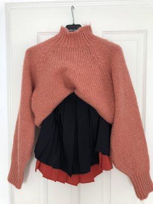 Falda plisada negro-rojo claro