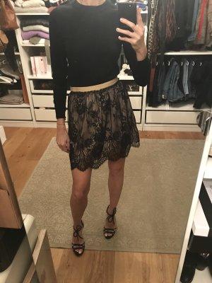 Zara Falda de encaje negro-rosa empolvado