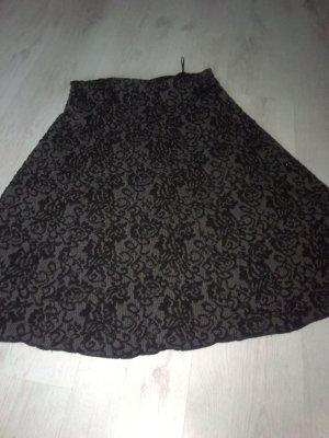 Falda asimétrica negro-color plata