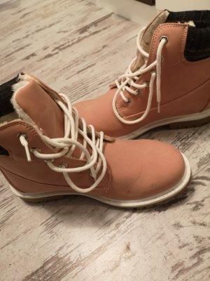 Botas de tobillo rosa empolvado