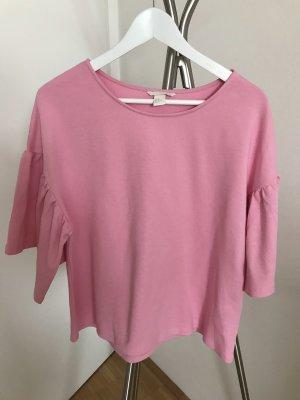 Rosa Shirt mit Glockenärmeln