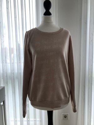 Rosa Sweatshirt mit weißer Schrift