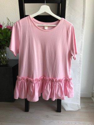 Rosa T-Shirt mit Schößchen