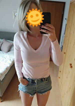 rosaner Pullover mit V-Ausschnitt Größe XS