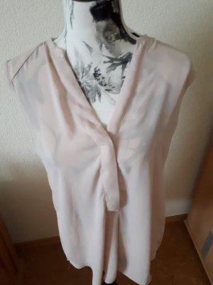 rosefarbene ärmellose Bluse