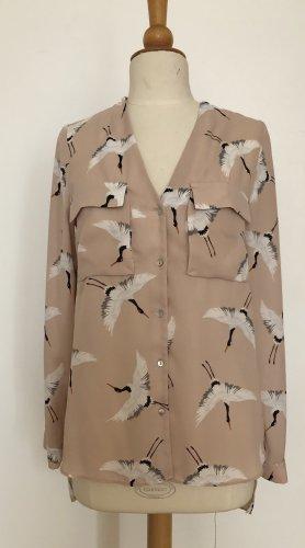 Rosefarbene Bluse mit Kranich-Print