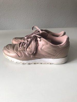 Roseglänzende Reebok Sneakers
