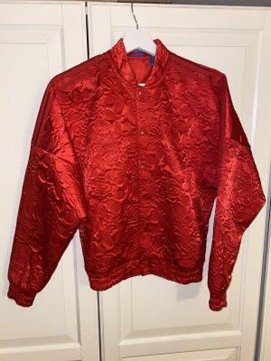 Rote Adidas Bomberjacke