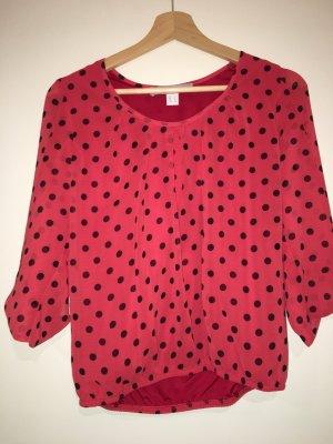 Rote Bluse mit Punkten