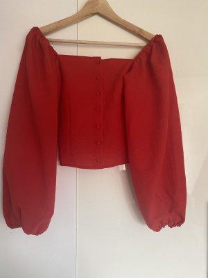 Rote Bluse mit quadratischem kragen
