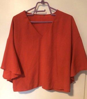 Rote Bluse V-Ausschnitt