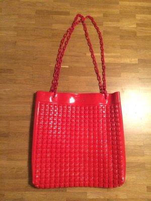 Rote Designer -Tasche im Lego-Look