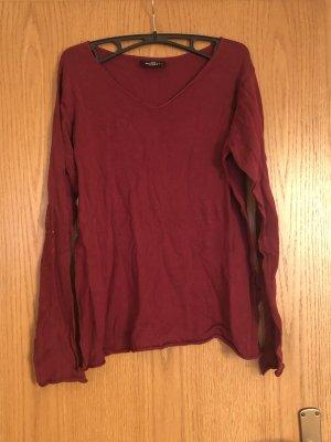 Roter langärmeliger Pullover
