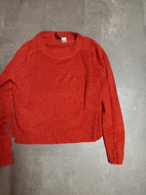 Pull en crochet rouge