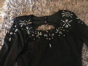 Rückenfreies Kleid mit Zirkonen