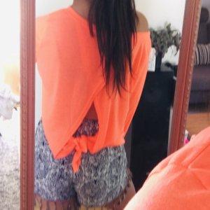 Top schiena coperta arancio neon