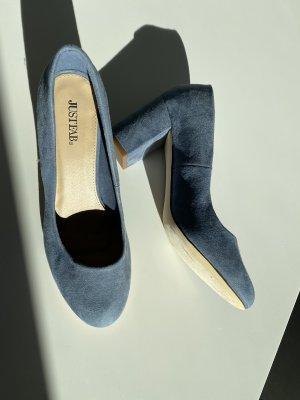 Runder hoher Schuh mit dickem Absatz