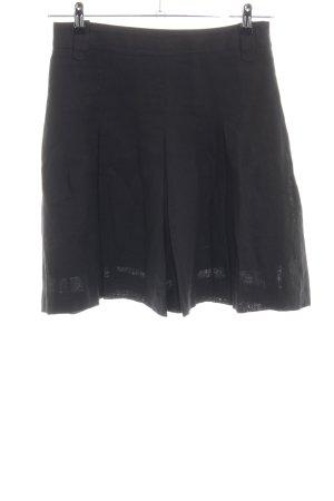 Falda de lino negro look casual