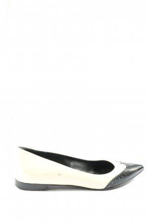 Saint Laurent Bailarinas plegables blanco-negro look casual