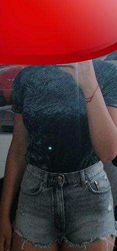 Camisa de cuello de tortuga azul