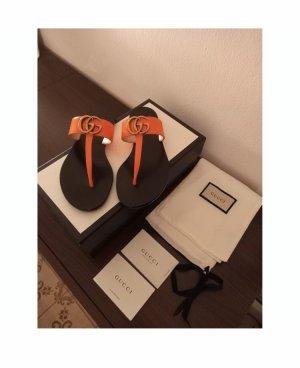 Gucci Sandalo toe-post arancione-nero