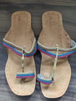 Sandales à lanière bleu fluo-rose