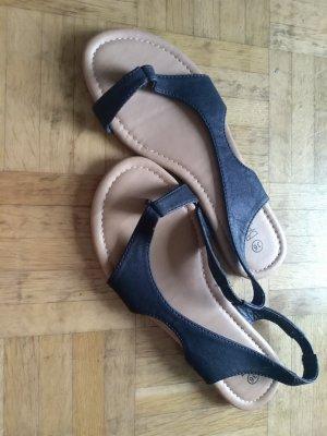 Sandalo con tacco alto e lacci a T nero