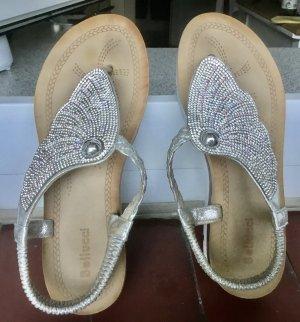 Sandalias con talón descubierto color plata-blanco