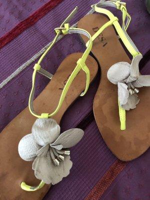 Desa Sandalias con talón descubierto blanco puro-amarillo Cuero
