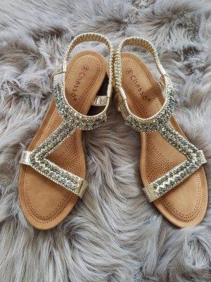Sandalias cómodas color oro