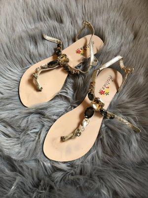 Sandalias con talón descubierto color oro-crema