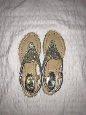 Sandalias con talón descubierto color oro