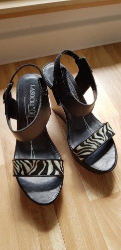 Sandalen hoch, schwarz-weiss. Sehr bequem, wie neu!