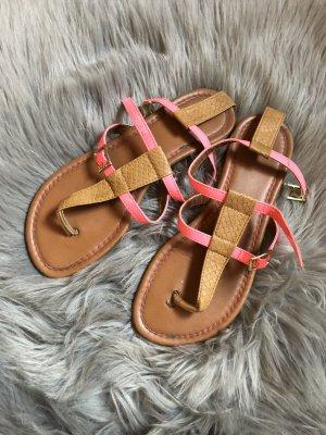 Sandalias con talón descubierto marrón-rosa neón