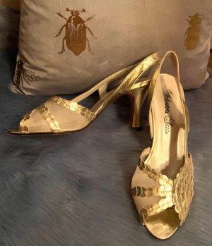 Sandalen met bandjes en hoge hakken goud