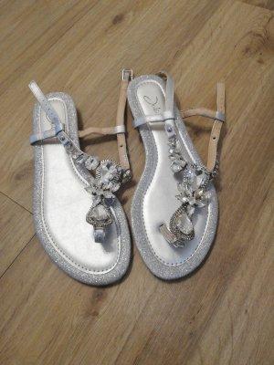 Juliet Sandały japonki z rzemykami srebrny