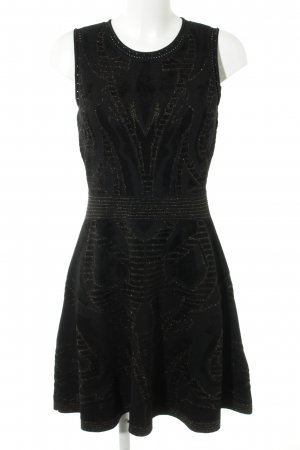 Sandro Paris Gebreide jurk zwart-goud abstract patroon elegant