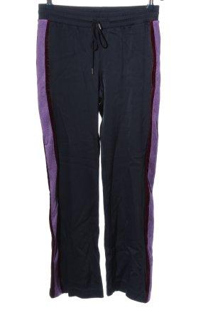 Sandro Broek met wijd uitlopende pijpen zwart-lila atletische stijl
