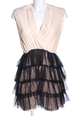 Sandro Vestido peplum crema-negro estampado floral elegante