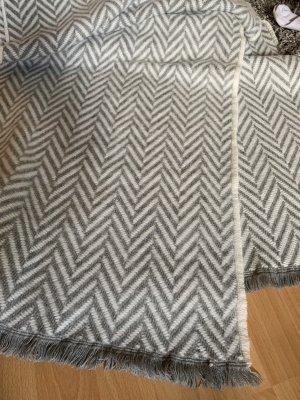 Bufanda de punto gris-blanco