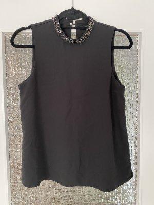 schicke bluse in schwarz mit hohem steinchenkragen