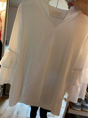 talk about Blusa brillante bianco
