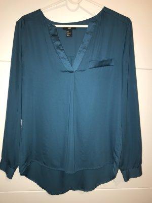 schicke leicht glänzende Bluse mit 3/4-Ärmeln