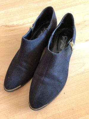 Schicke Schwarze Schuhe mit Gold Details