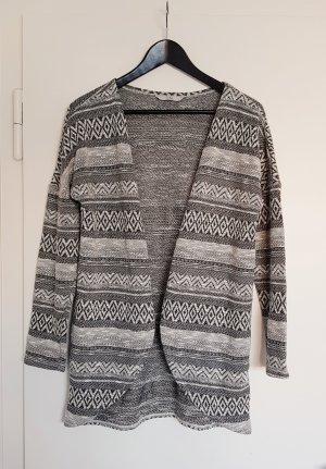 Schicke Strickjacke, Schwarz-Weiß-Muster