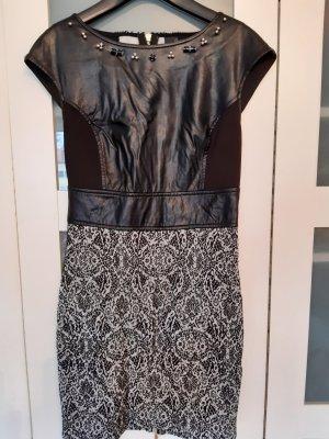 Schickes Kleid mit Lederoptik