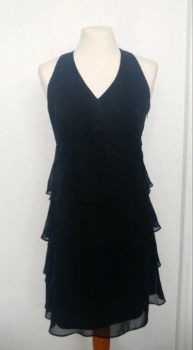Schickes schwarzes Kleid mit Volants Neckholder